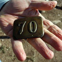 Elder Marlin K. Jensen holds a gift for his 70th birthday in Huntsville, Thursday, Sept. 27, 2012.