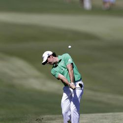 Rory McIlroy, of Northern Ireland, hits on the fairway of the fourth hole during the final round of the Tour Championship golf tournament on Sunday, Sept. 23, 2012, in Atlanta.