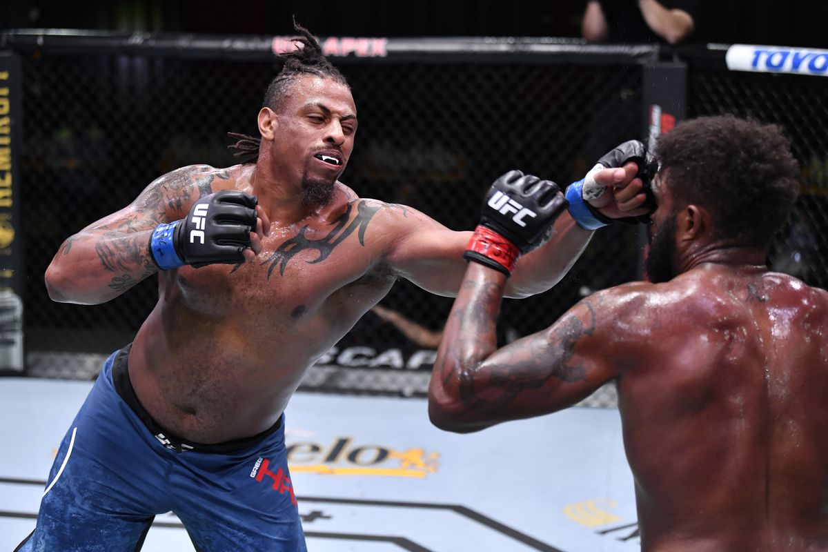 Greg Hardy punches Maurice Greene in a heavyweight bout during the UFC Fight Night event at UFC APEX on October 31, 2020 in Las Vegas, Nevada.