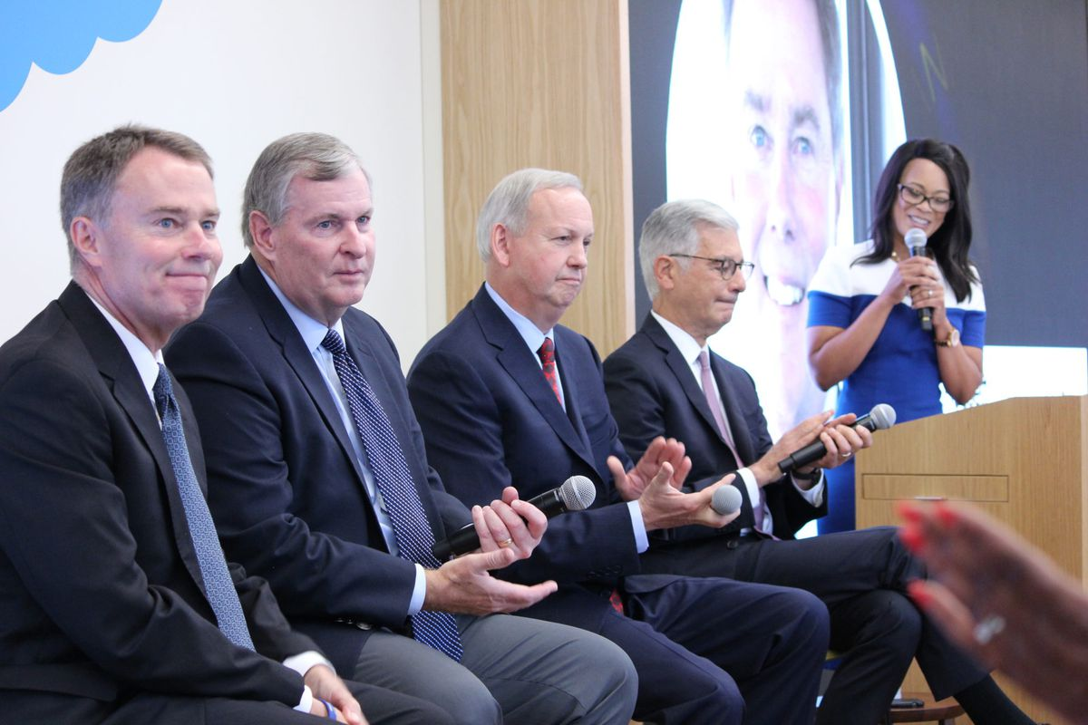 Indianapolis Mayor Joe Hogsett (left), and former mayors Greg Ballard, Bart Peterson, and Stephen Goldsmith speak on a panel Thursday about fighting poverty moderated by Fox59 anchor Fanchon Stinger.