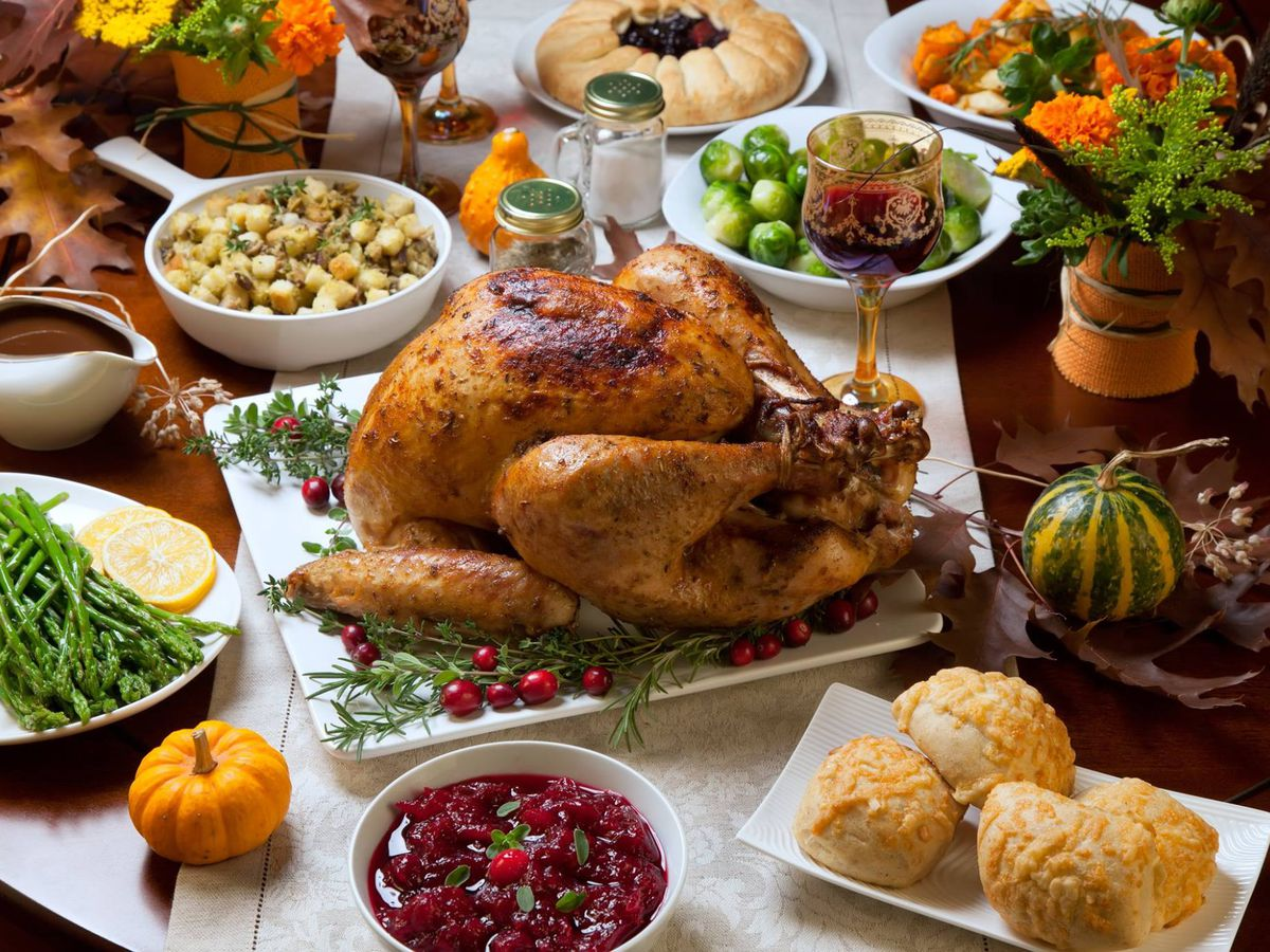 A roasted turkey surrounded by all the trimmings