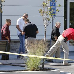 Law enforcement investigate the scene where Darrien Hunt, 22, was shot and killed by police in Saratoga Springs on Wednesday, Sept. 10, 2014. Investigators on Saturday said he brandished a Samurai sword and lunged toward officers, prompting them to shoot him.