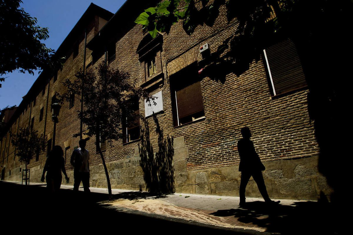 """In this July 28, 2011 file photo, pedestrians walk by the closed order convent of the Trinitarias Descalzas, where the Spanish writer Miguel de Cervantes, author of """"El Quijojte"""", was buried in Madrid, Spain."""