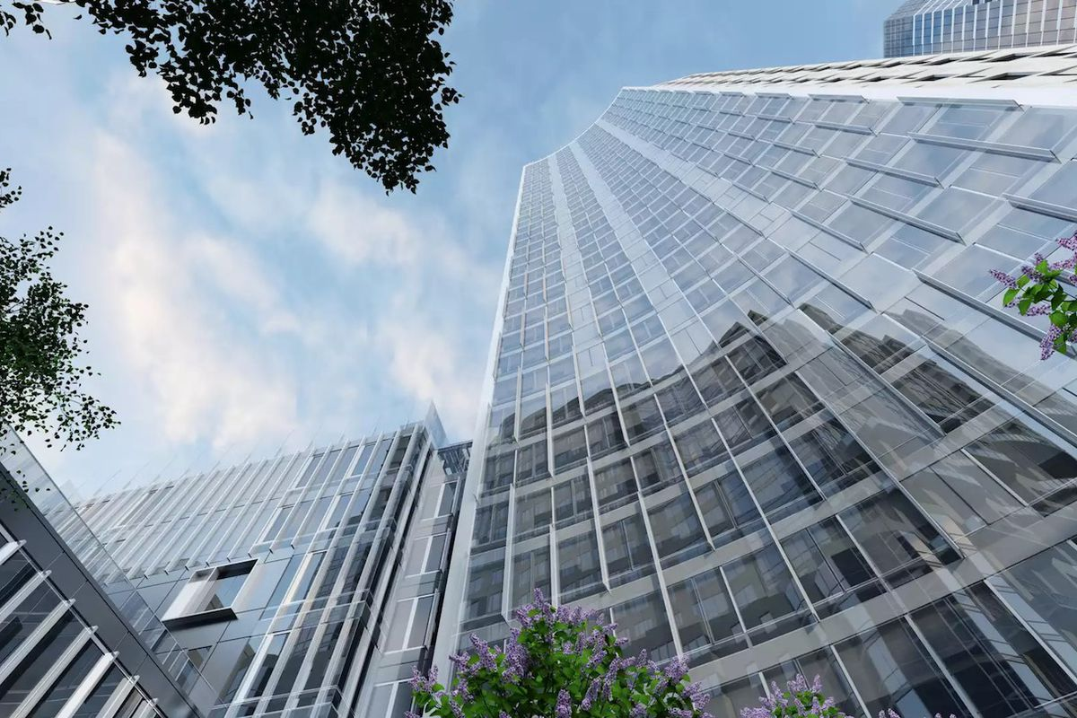 A low-angle photo of a glass high-rise.
