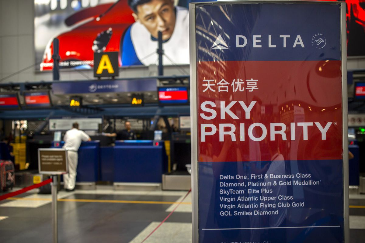 In this July 6, 2018 photo, travelers check in for flights at the Delta Air Lines check-in counters at Beijing Capital International Airport. Chinese regulators said Thursday, June 4, 2020, that more foreign airlines will be allowed to fly to China as anti-coronavirus controls ease but it was unclear whether the change will defuse a fresh conflict with the Trump administration over air travel.