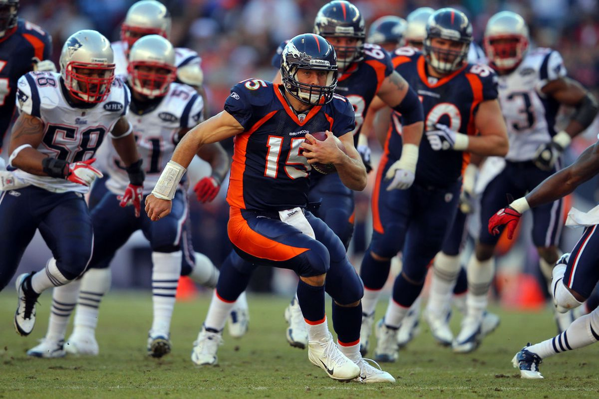 DENVER, CO - DECEMBER 18:  Quarterback Tim Tebow #15 of the Denver Broncos runs with the ball against the New England Patriots at Sports Authority Field at Mile High on December 18, 2011 in Denver, Colorado.  (Photo by Doug Pensinger/Getty Images)