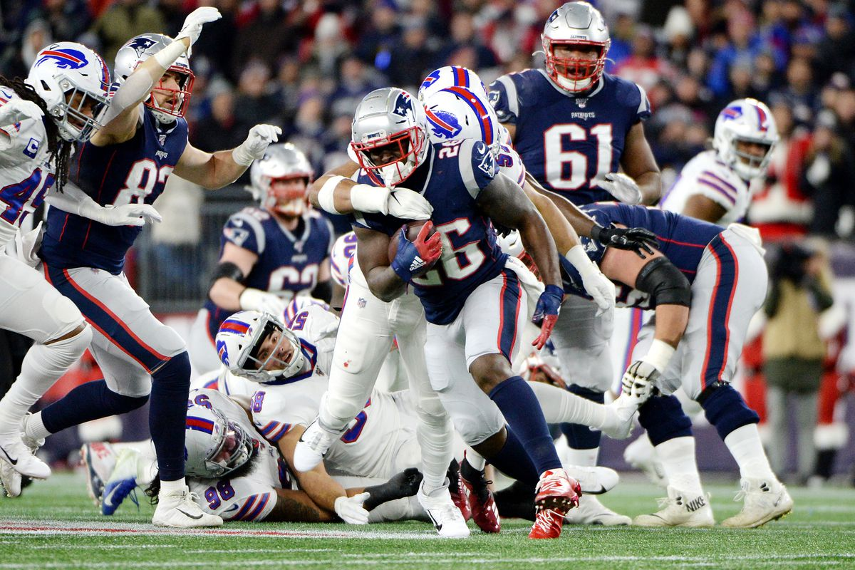 Sony Michel of the New England Patriots runs with the ball during the first half against the Buffalo Bills in the game at Gillette Stadium on December 21, 2019 in Foxborough, Massachusetts.