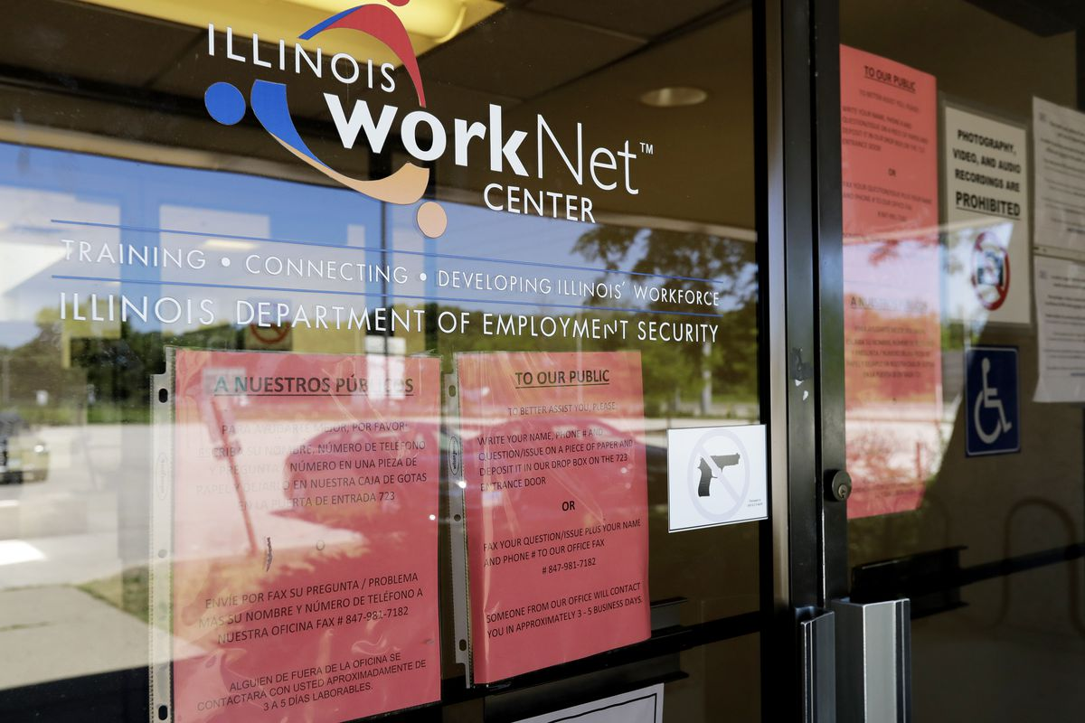 Information signs are displayed at an Illinois Department of Employment Security WorkNet center in Arlington Heights in June.