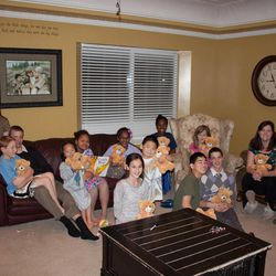 """The family holds """"Cuddle Bears,"""" which they were given for comfort a few weeks after the death of the Walkers' 3-year-old son, Gideon. The Walkers say their knowledge of eternal families has been able to get them through."""