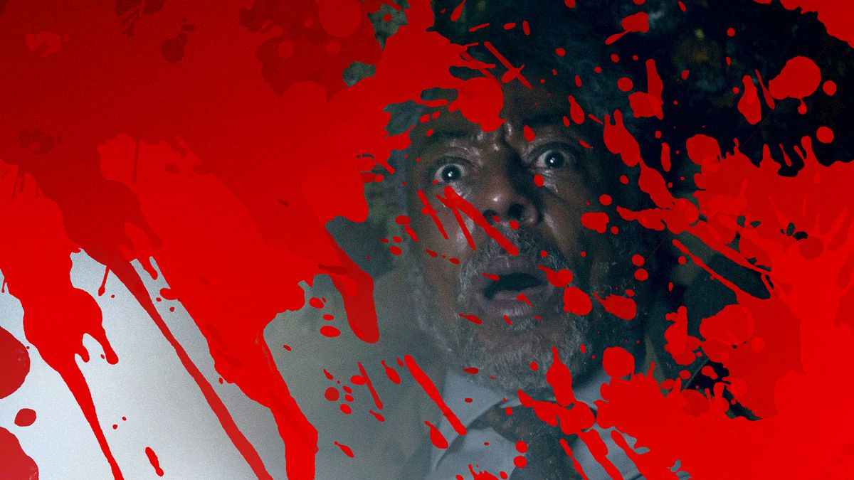 Actor Giancarlo Esposito looks terrified with graphic overlay of blood