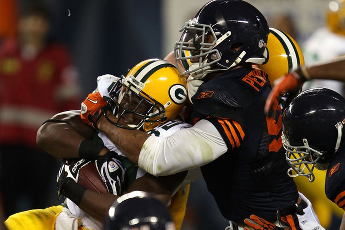 Julius Peppers #99 of the Chicago Bears tackles Brandon Jackson #32 of the Green Bay Packers at Soldier Field on September 27 2010 in Chicago Illinois.  (Photo by Jonathan Daniel/Getty Images)