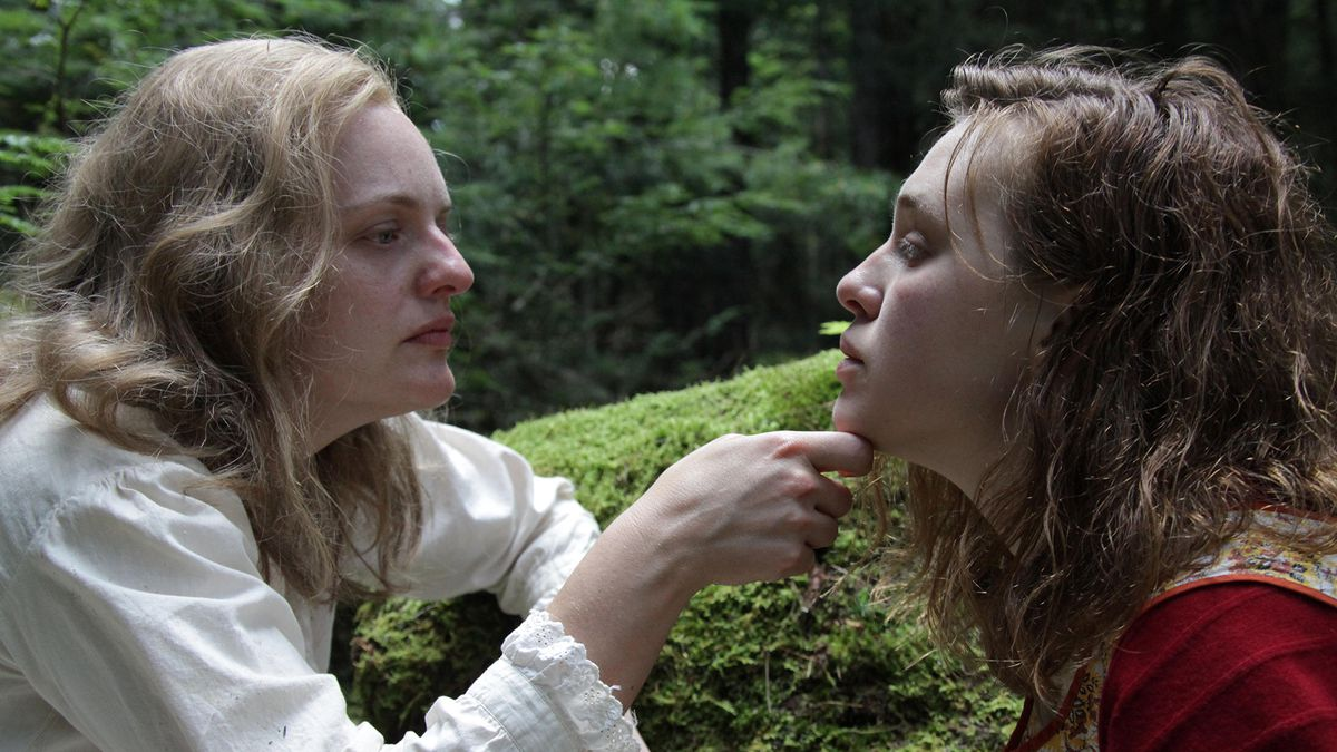 Elisabeth Moss lifts Odessa Young's face with a finger under the chin in Shirley