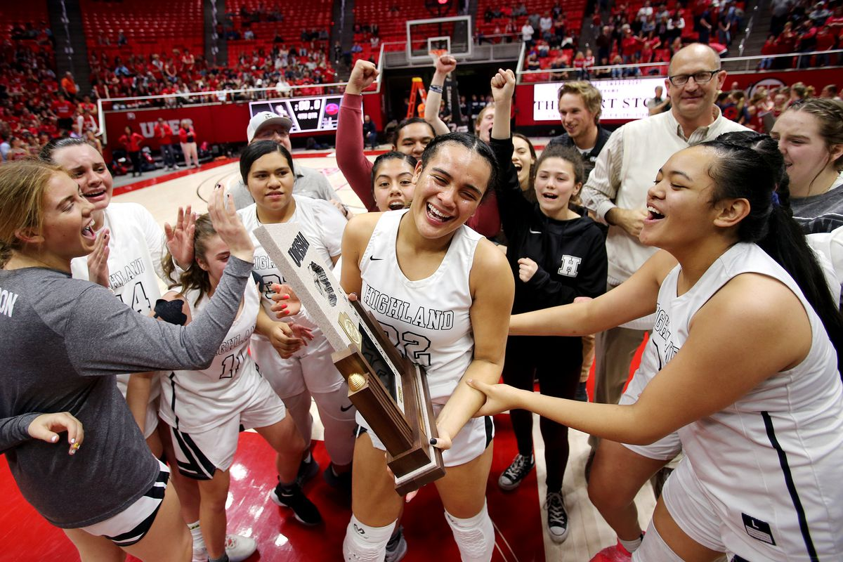Highland's Kaija Glasker hold the championship trophy as the Rams celebrate their win over Springville in the 5A State Basketball Championship in the Huntsman Center at the University of Utah in Salt Lake City on Saturday, Feb. 29, 2020. Highland won 46-34.