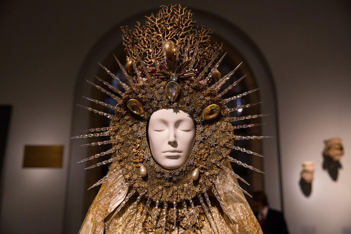 A mannequin wears an elaborate headdress.