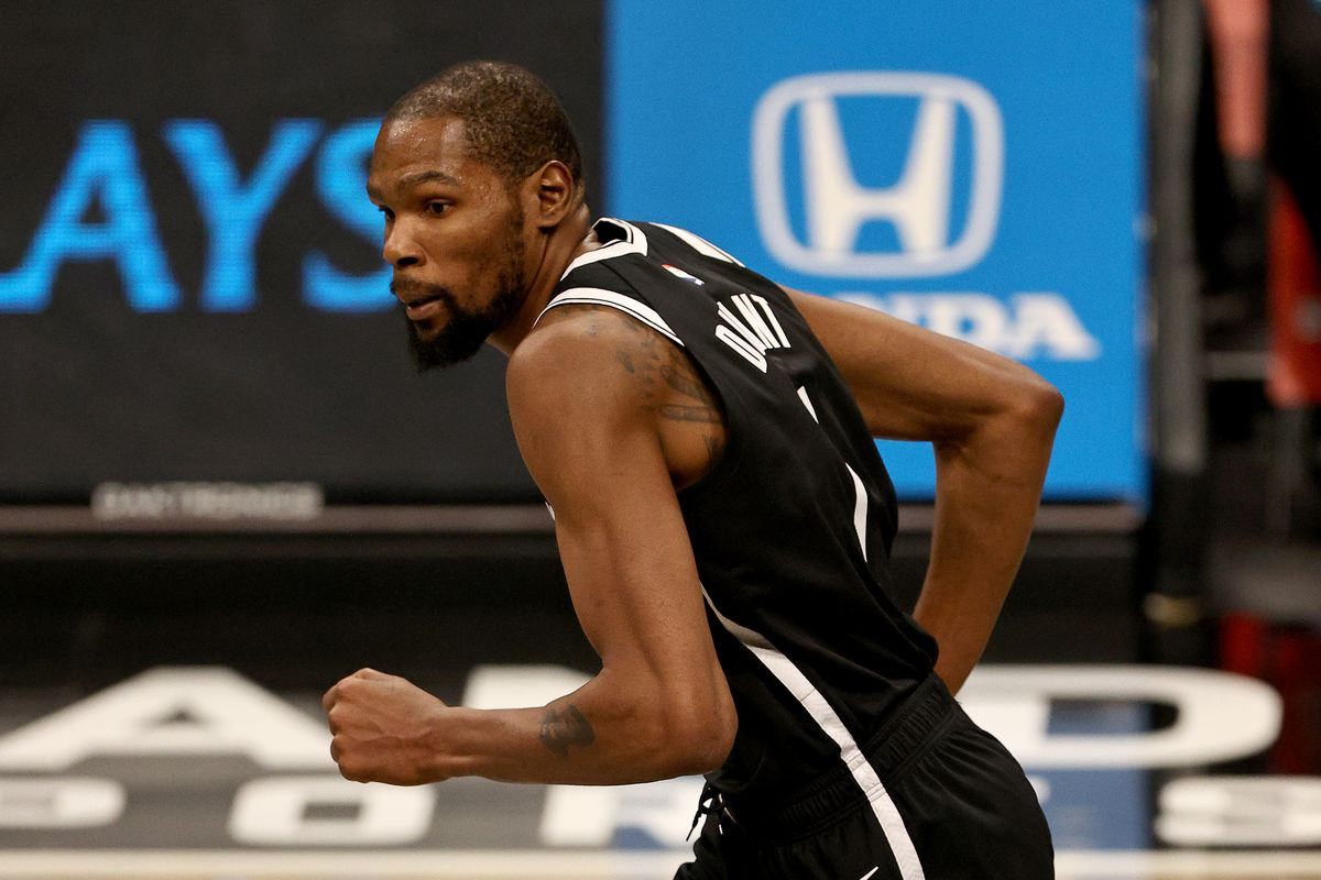 Kevin Durant of the Brooklyn Nets celebrates his shot in the second half against the Miami Heat at Barclays Center on January 23, 2021 in New York City.