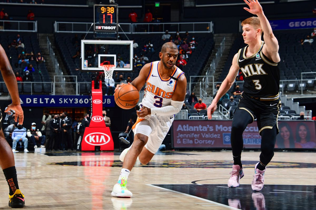 Chris Paul #3 of the Phoenix Suns drives to the basket against the Atlanta Hawks on May 5, 2021 at State Farm Arena in Atlanta, Georgia.