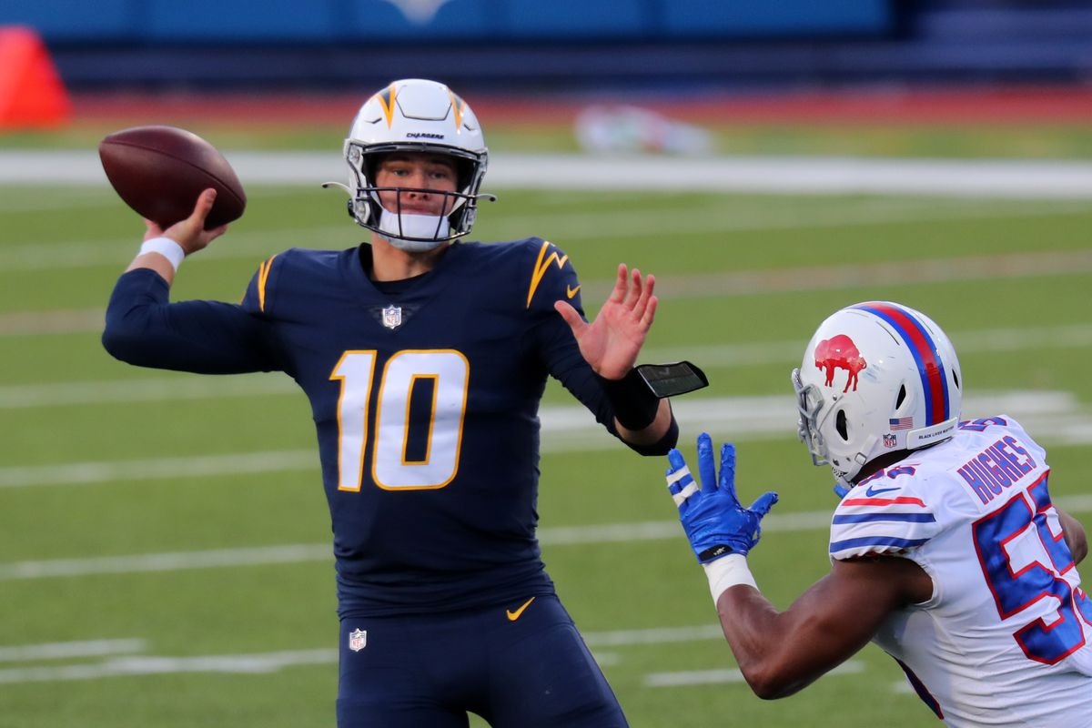 Justin Herbert #10 of the Los Angeles Chargers throws a pass against the Buffalo Bills at Bills Stadium on November 29, 2020 in Orchard Park, New York.