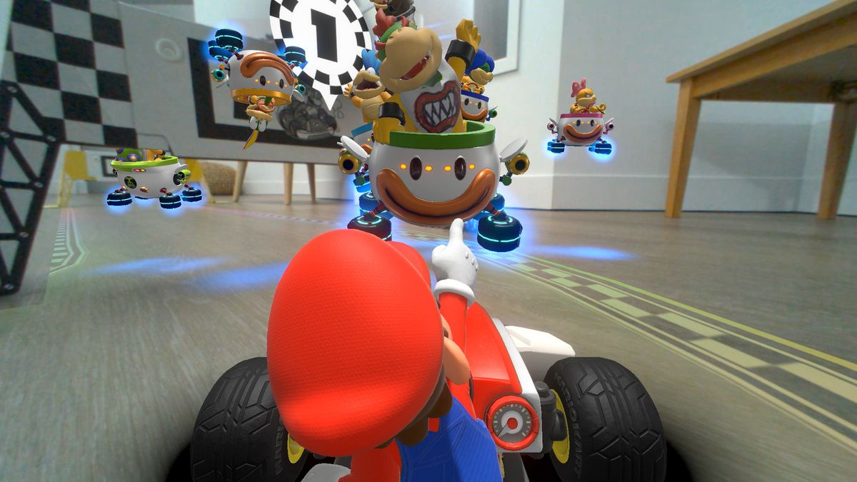 Mario points at Bowser Jr. and the Koopalings in a screenshot from Mario Kart Live: Home Circuit