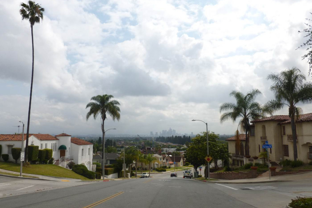 Mount Vernon Boulevard, streetscape and view of Downtown Los Angeles, facing east