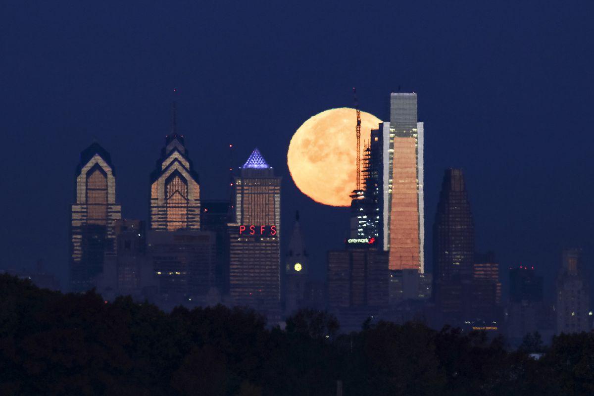 The supermoon sets behind the Philadelphia skyline on Monday, Nov. 14, 2016.