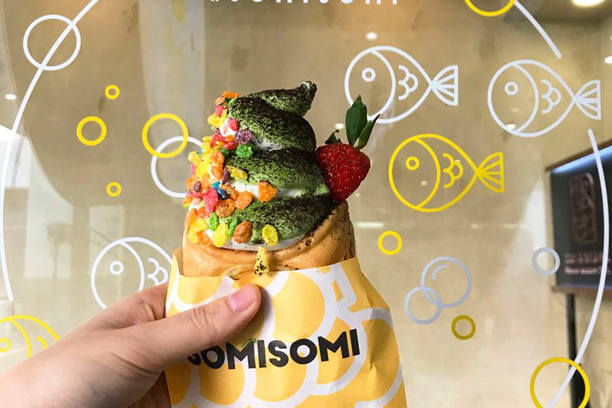 A fish-shaped cone with soft serve ice cream inside