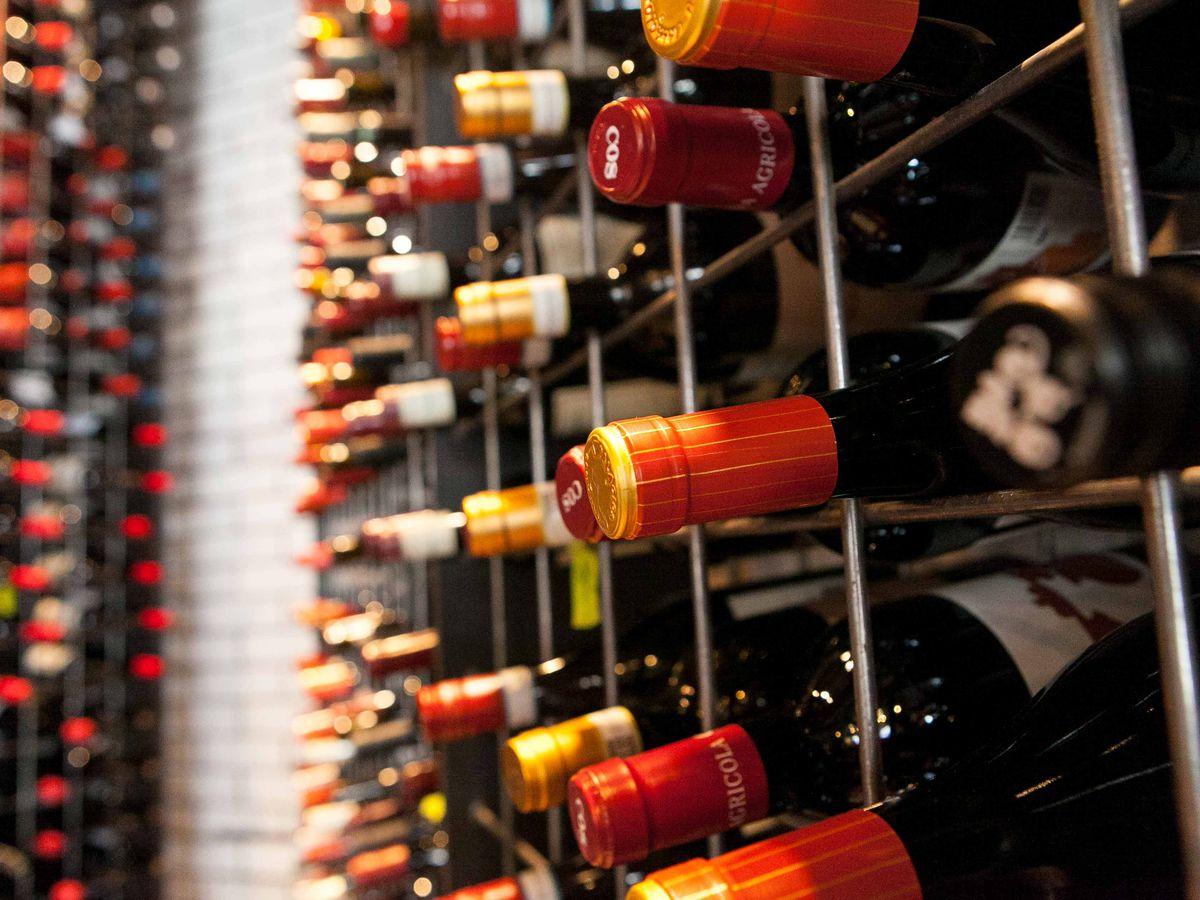 bottles of wine stacked on shelves