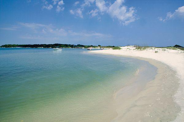 A white sand beach and the ocean.
