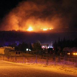 A large fire seen after an explosion at an ammunition store in Afyonkarahisar in western Turkey which has killed some 25 soldiers and wounded at least four others, Thursday, Sept. 6, 2012. The blast happened on Wednesday night at a military storage for hand grenades in Afyon, military said. Environment Minister Veysel Eroglu said the explosion was most likely caused by an accident and certainly not as a result of terrorism. It is thought many of the soldiers were trapped inside the building as firefighters tackled the huge blaze. (AP Photo) TURKEY OUT