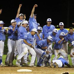 Pleasant Grove players celebrate as they defeat Bingham Wednesday, May 21, 2014 in a 5A one-loss bracket game at Kearns. Pleasant Grove won 5-4.