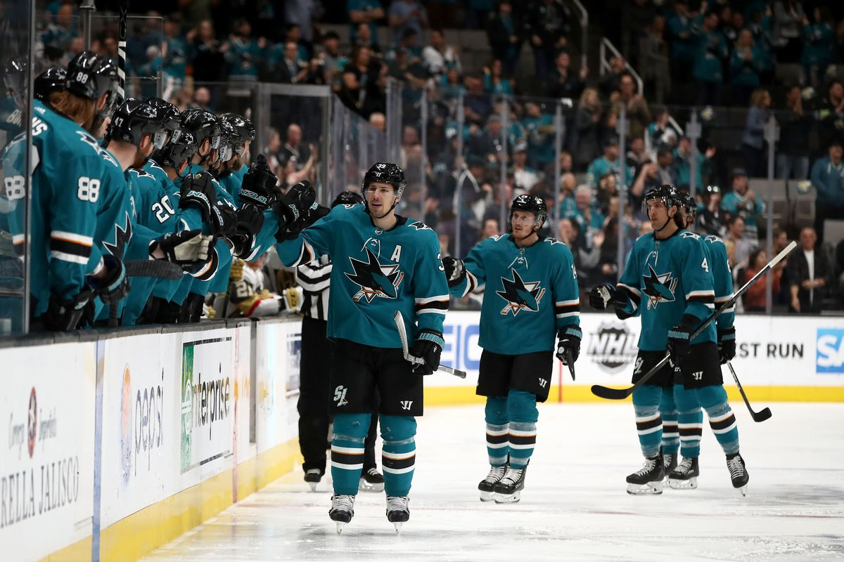 SAN JOSE, CALIFORNIA - MARCH 18: Logan Couture #39 of the San Jose Sharks is congratulated by teammates after he scored a goal against the Vegas Golden Knights at SAP Center on March 18, 2019 in San Jose, California.