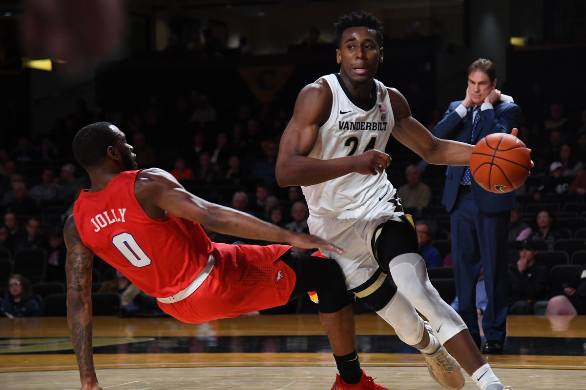 Vanderbilt Commodores forward Aaron Nesmith is called for charging on a play against Southern Methodist Mustangs guard Tyson Jolly during the first half at Memorial Gymnasium.