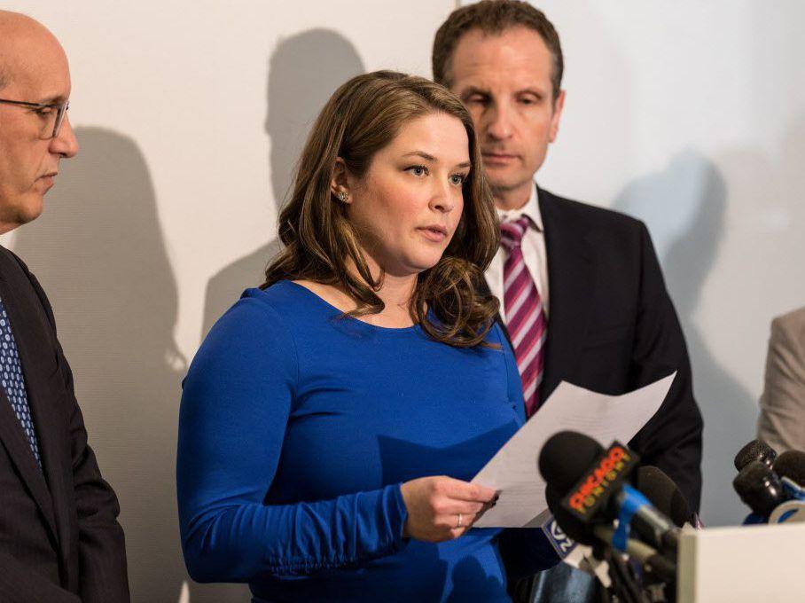 Alaina Hampton speaks at a press conference