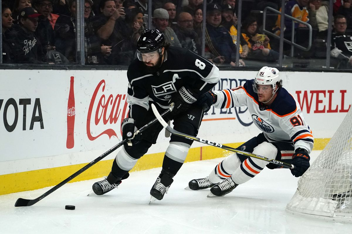 Los Angeles Kings defenseman Drew Doughty is pursued by Edmonton Oilers center Gaetan Haas  in the first period at Staples Center.
