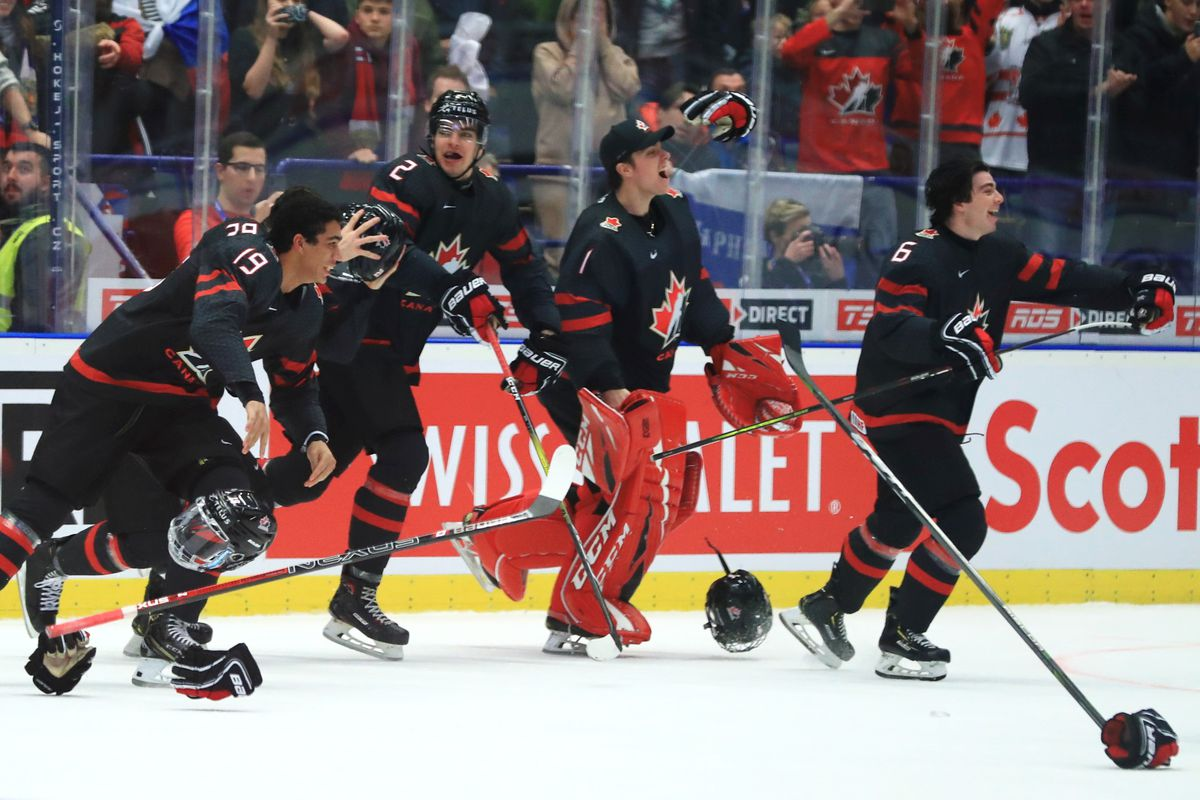 Canada's Quinton Byfield, Kevin Bahl, Nicolas Daws, and Jamie Drysdale (L-R) celebrate victory in the 2020 World Junior Ice Hockey Championship final match between Canada and Russia at Ostravar Arena; Canada won 4-3.