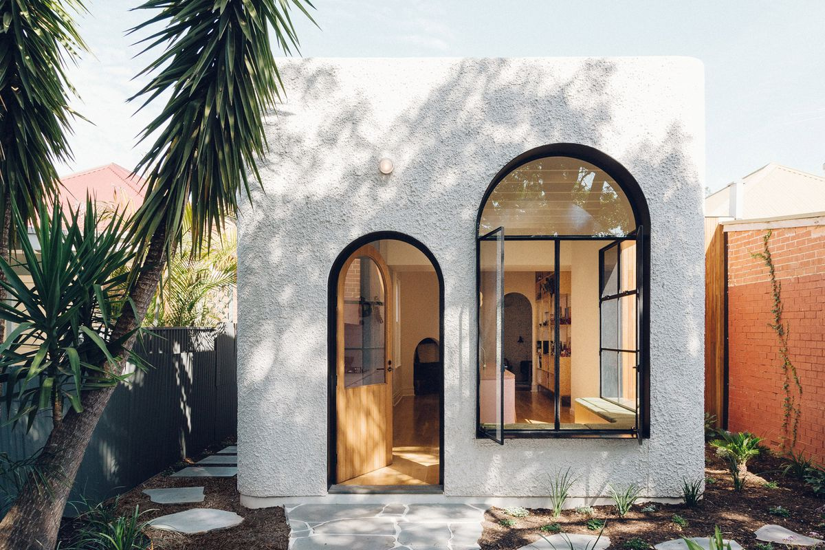 White stucco house with arched doors and windows