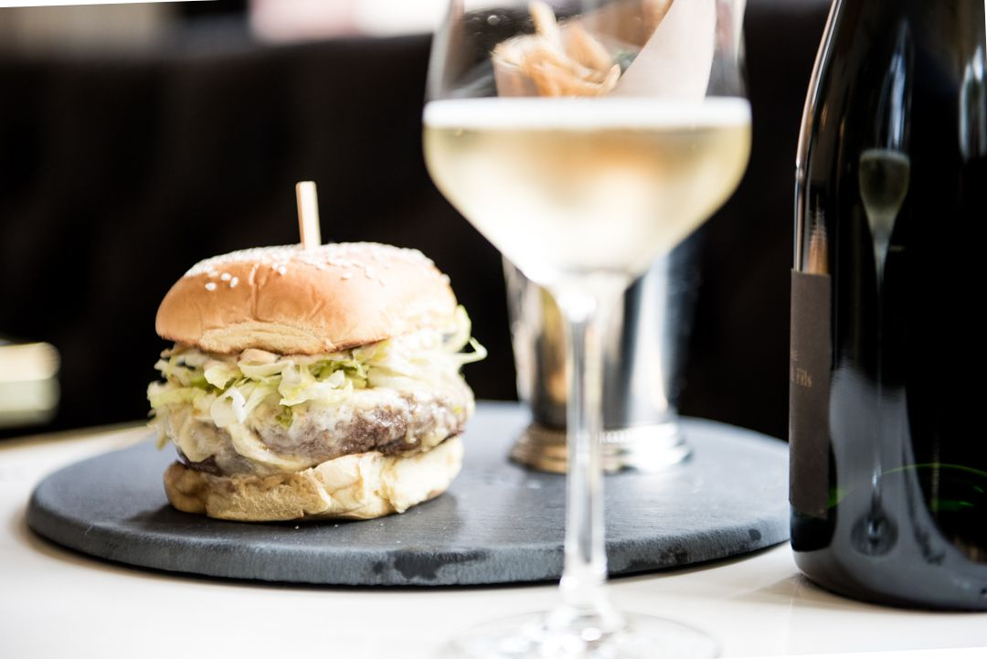 A burger and a glass of Champagne