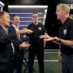 Former Gov. Gary Herbert, left, talks with BYU athletic director Tom Holmoe during BYU Football Media Day at the BYU Broadcasting Building in Provo on Thursday, June 17, 2021. Derek Miller, president and CEO of the Salt Lake Chamber and Downtown Alliance, and Gary Veron, BYU associate athletic director for student-athlete experience, listen.