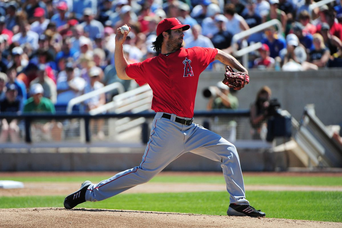 March 23, 2012; Phoenix, AZ, USA; Los Angeles Angels starting pitcher Dan Haren (24) delivers a pitch during the first inning against the Milwaukee Brewers at Maryvale Baseball Park. Mandatory Credit: Kyle Terada-US PRESSWIRE