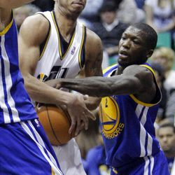 Utah Jazz guard Devin Harris (5) is tied up by Golden State's #2 Nate Robinson as the Utah Jazz and the Golden State Warriors play Friday, April 6, 2012 in Salt Lake City. Jazz won 104-98.