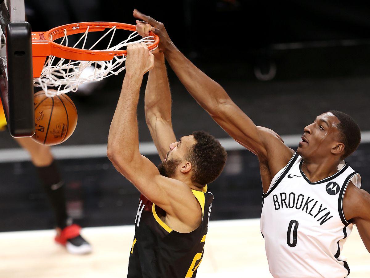 Utah Jazz center Rudy Gobert (27) dunks with Brooklyn Nets forward Reggie Perry (0) defending.