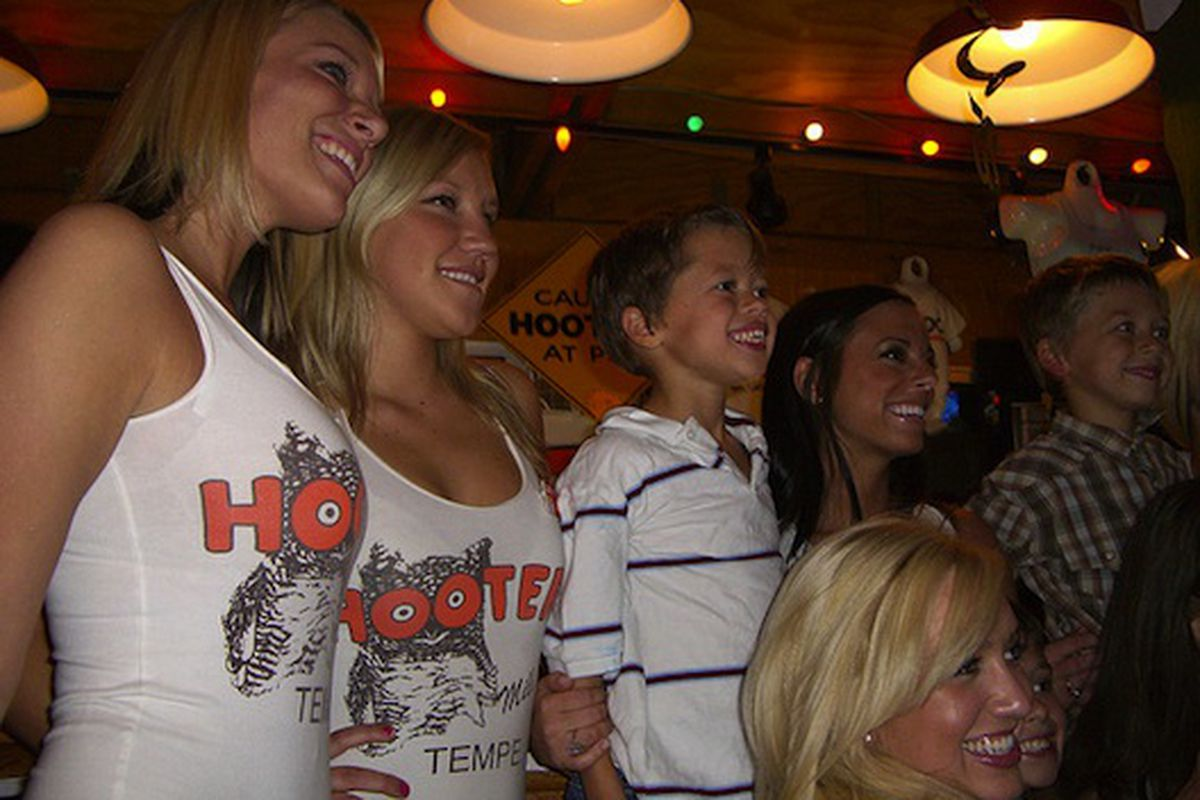 Some kids having a birthday party at Hooters.
