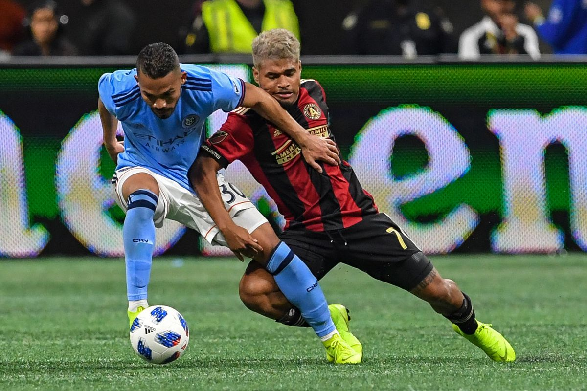 New York City midfielder Yangel Herrera (30) and Atlanta United forward Josef Martinez (7) fight for the ball during the first half in the Eastern Conference semifinal at Mercedes-Benz Stadium.