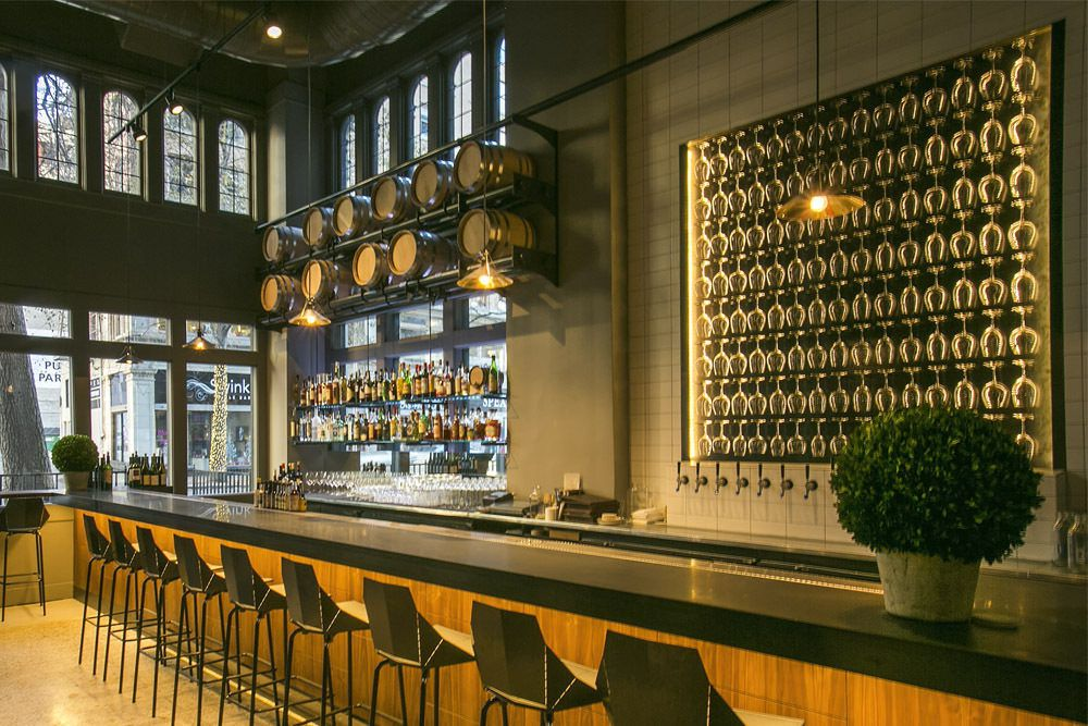 A view of the striking golden-hued bar at Miller's Guild.