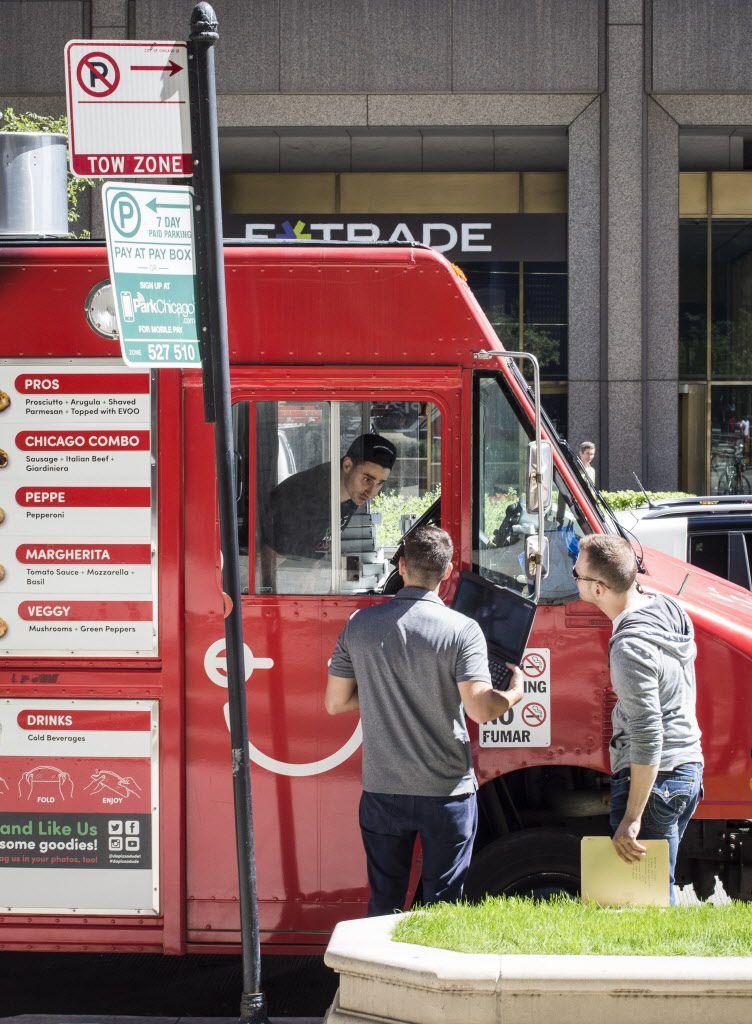 City inspectors question Francesco Abate of Da Pizza Dude. | Rich Hein / Sun-Times