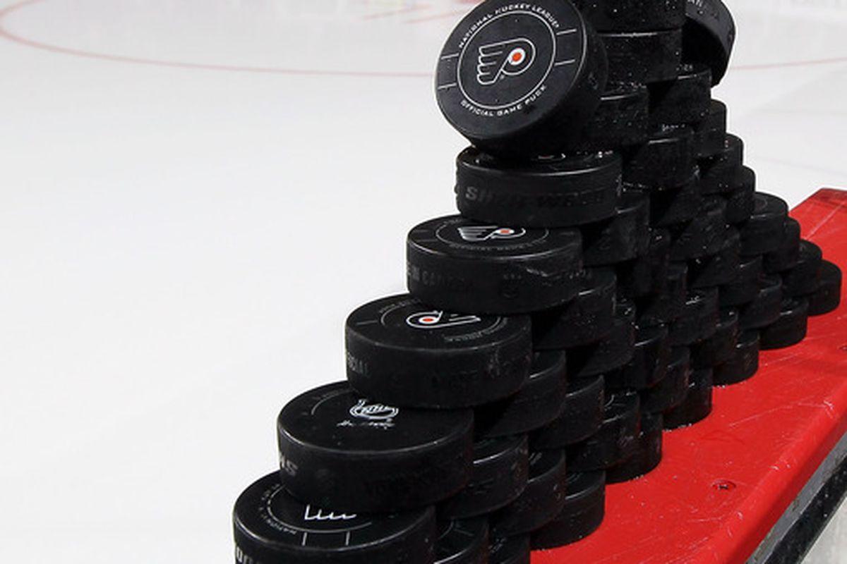 PHILADELPHIA, PA - OCTOBER 22:  Pucks are seen before the Philadelphia Flyers and St. Louis Blues warm up for their game on October 22, 2011 at Wells Fargo Center in Philadelphia, Pennsylvania.  (Photo by Jim McIsaac/Getty Images)
