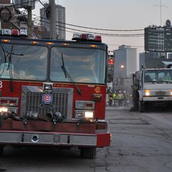 Another view of Engine 78 as the street sweeper works on Waveland