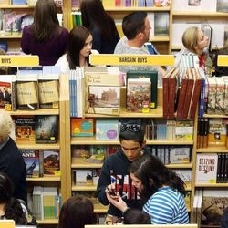 Admirers wait in a long line winding through the store to talk to David Archuleta as he signs magazines and CDs during a book signing event at the Deseret Book at Ft. Union in Midvale on Nov. 22.