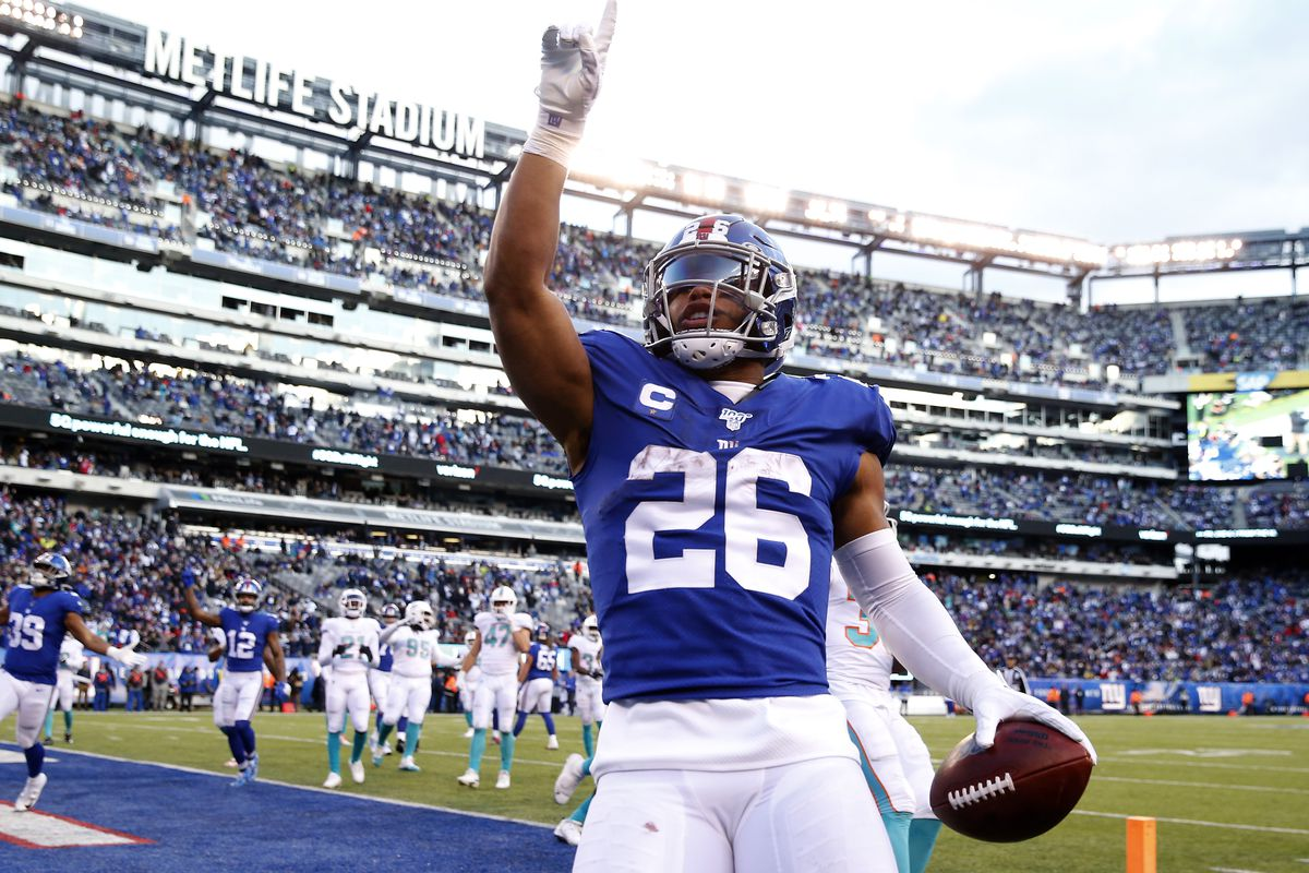 Saquon Barkley #26 of the New York Giants celebrates his touchdown in the fourth quarter against the Miami Dolphins at MetLife Stadium on December 15, 2019 in East Rutherford, New Jersey.The New York Giants defeated the Miami Dolphins 31-13.