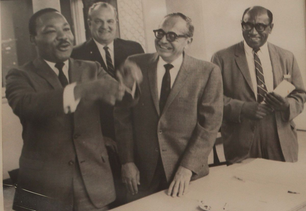 A 1965 photo of Timuel Black (far right) with the Rev. Martin Luther King Jr. (far left). Black activists demonstrated for open housing with King in Marquette Park.