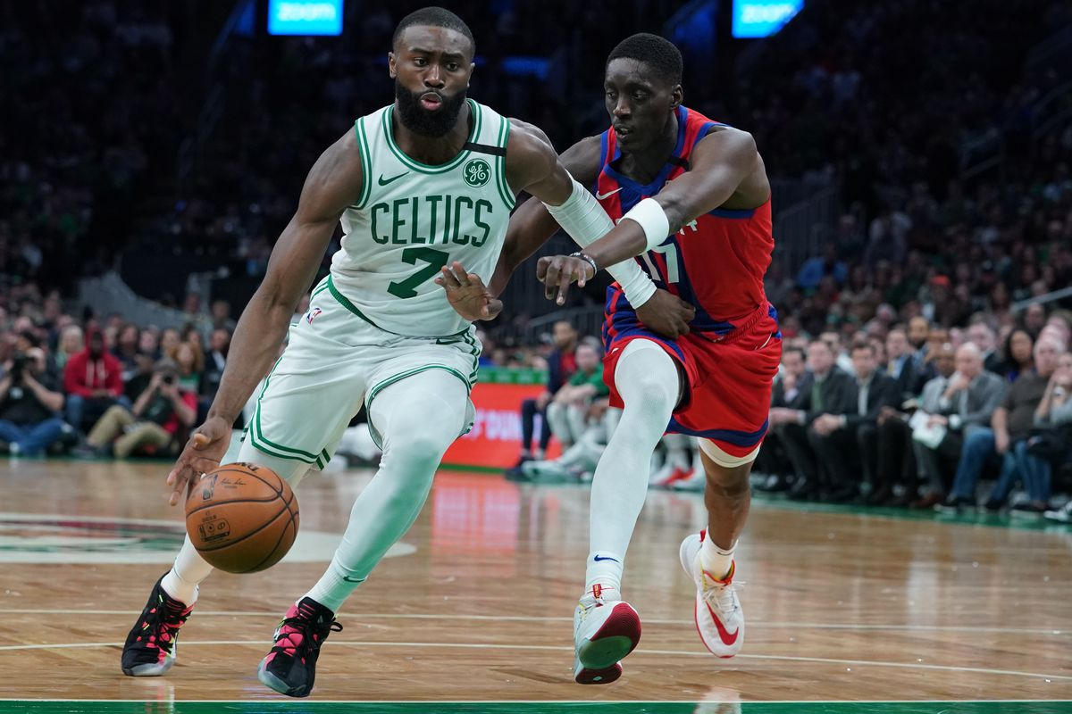 Boston Celtics guard Jaylen Brown drives the ball against Detroit Pistons guard Tony Snell in the second half at TD Garden. The Pistons defeated the Celtics 116-103.